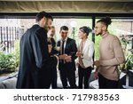 small group of business people... | Shutterstock . vector #717983563