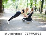 young fitness mother exercising ... | Shutterstock . vector #717993913