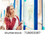 confused girl thinking about... | Shutterstock . vector #718003387