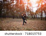 taking a walk in the forest of... | Shutterstock . vector #718015753