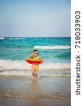 child at sea. selective focus. | Shutterstock . vector #718033903