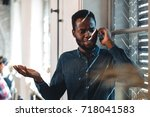 young black man talking on the... | Shutterstock . vector #718041583