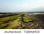 beach scenery made of volcanic... | Shutterstock . vector #718046923
