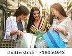 girls watching their  new...   Shutterstock . vector #718050643