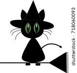 cute cartoon black cat in witch ... | Shutterstock .eps vector #718060093