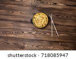instant noodles in wooden bowl... | Shutterstock . vector #718085947