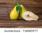 pears fruits on old wooden... | Shutterstock . vector #718085977