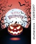 jack o lantern glowing at... | Shutterstock .eps vector #718092097
