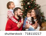 happy family with two children... | Shutterstock . vector #718110217