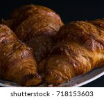 Three Croissants On A White...