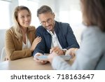 mature couple meeting real... | Shutterstock . vector #718163647