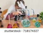 student boy in chemistry class... | Shutterstock . vector #718174327