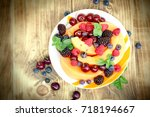 fresh fruit salad made with... | Shutterstock . vector #718194667