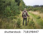 hunter with a backpack and a... | Shutterstock . vector #718198447