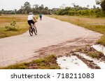 cyclist in motion on the public ... | Shutterstock . vector #718211083