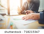 co workers are consultants on... | Shutterstock . vector #718215367