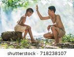 two little boys sitting on a... | Shutterstock . vector #718238107