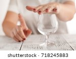 woman refuses to drink a alcohol | Shutterstock . vector #718245883