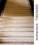 Small photo of A stairs that made from orange tiles with handrail, picture show the front of stairs.