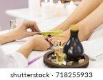 pedicure at beauty salon. nail... | Shutterstock . vector #718255933