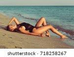 beauty at the beach   Shutterstock . vector #718258267