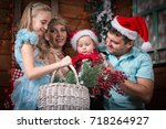 family in the room decorated... | Shutterstock . vector #718264927