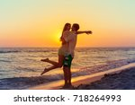 happy family on the beach | Shutterstock . vector #718264993