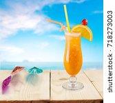 cocktail on beach.   Shutterstock . vector #718273003