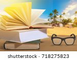 book and glasses on beach.   Shutterstock . vector #718275823