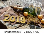 champagne on a stony beach by...   Shutterstock . vector #718277737