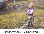 little girl with bike in the... | Shutterstock . vector #718285903