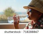 cute boy in checkered shirt... | Shutterstock . vector #718288867