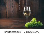 beautiful white wine in wine... | Shutterstock . vector #718293697