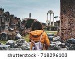 woman tourist with orange coat... | Shutterstock . vector #718296103