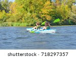 family kayaking  mother and... | Shutterstock . vector #718297357