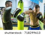 young handsome boxer doing... | Shutterstock . vector #718299613