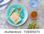 honey and honeycomb on the... | Shutterstock . vector #718305673