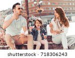 young family couple with... | Shutterstock . vector #718306243