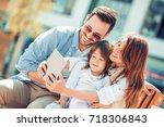 portrait of happy family having ... | Shutterstock . vector #718306843