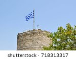 flag on kavala ancient tower in ... | Shutterstock . vector #718313317
