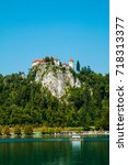 bled castle by the lake ... | Shutterstock . vector #718313377
