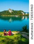 girls reading books by the lake ... | Shutterstock . vector #718314463