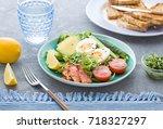 healthy salad with avocado ... | Shutterstock . vector #718327297