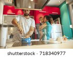 lovely family in kitchen... | Shutterstock . vector #718340977