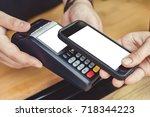 person paying pay through... | Shutterstock . vector #718344223