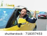 emotional male taxi driver... | Shutterstock . vector #718357453
