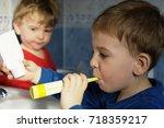 kids brushing teeth | Shutterstock . vector #718359217