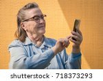 portrait of old lady ... | Shutterstock . vector #718373293