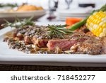 delicious medium marbled steak... | Shutterstock . vector #718452277