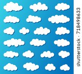 set of white clouds on a blue... | Shutterstock .eps vector #718498633